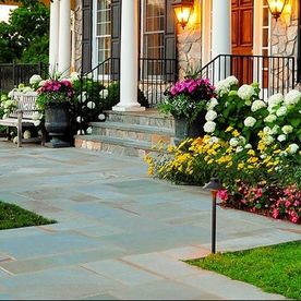 front yard with flower beds and walkway